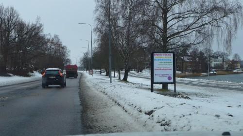 GUSO reklamskylt på Norra Kungsvägen