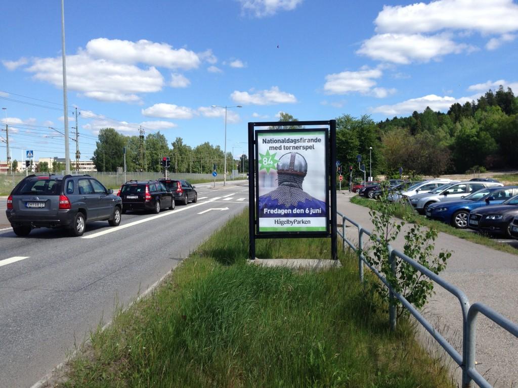 Guso reklamskylt Huddingevägen annonsör Hågelbyparken